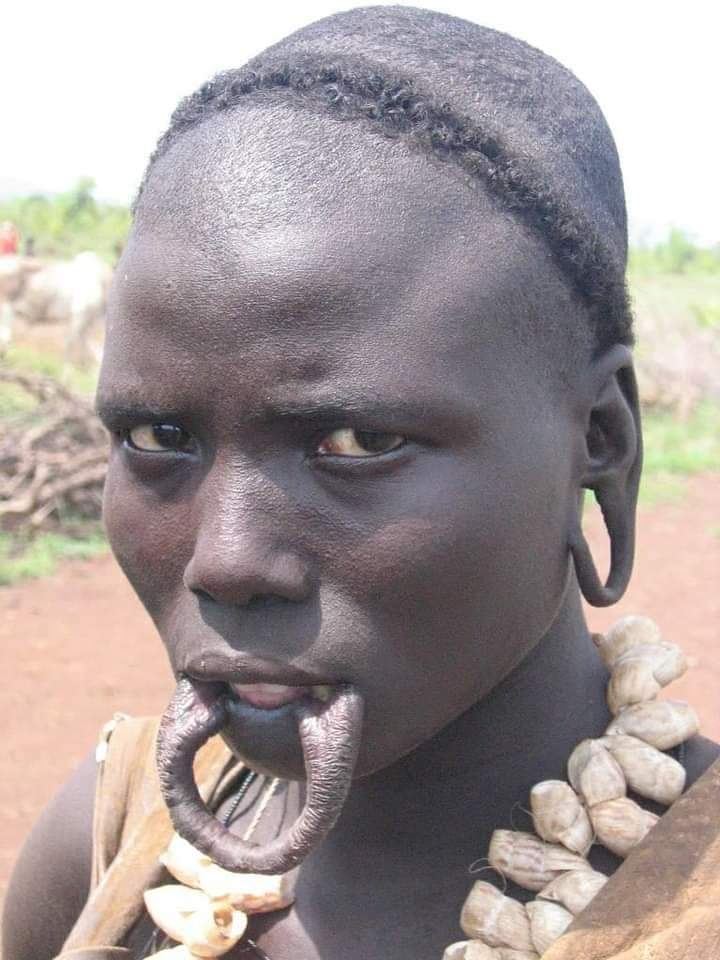A mursi woman without her lip plate