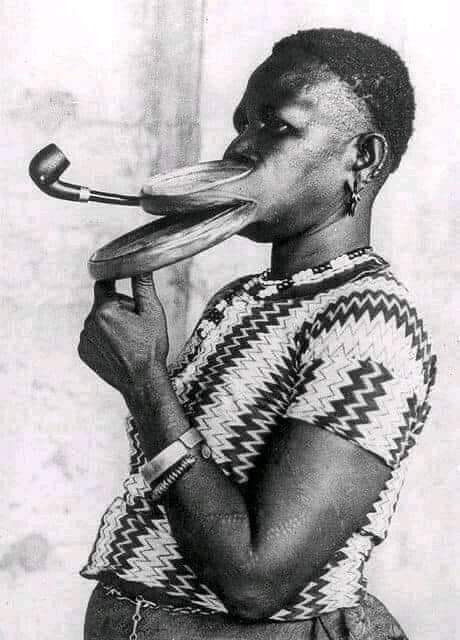 A mursi woman with double lip plates